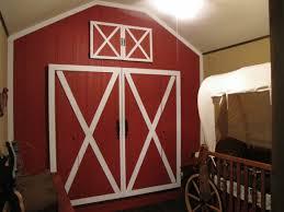 cute cowboy room wall painted like a barn door nursery ideas