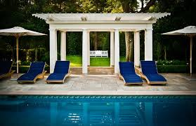 free standing patio covers pool traditional with blue pool chairs