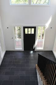 white walls black door and tile floor all that u0027s needed is a