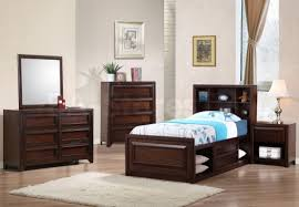 dark brown wooden bedside table next to dark brown wooden bed