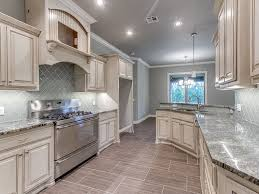 Travertine Tiles Kitchen Traditional Kitchen With Custom Hood U0026 Raised Panel Zillow Digs