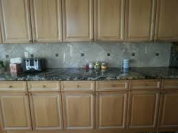 integrity installations division front range kitchen after marble backsplash with inserts magma gold granite