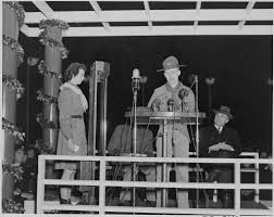 file photograph of a boy scout speaking at the ceremonial lighting