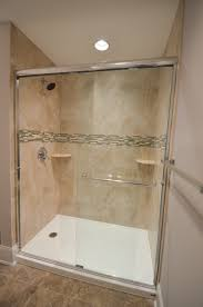 glass walk in shower with tile feature strip for a pop of color
