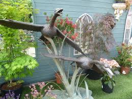 two bronze swans flying water feature in bronze garden statues