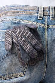 working tools in the back pocket of old used jeans stock photo