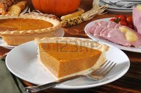 a slie of pumpkin pie with and a thanksgiving dinner