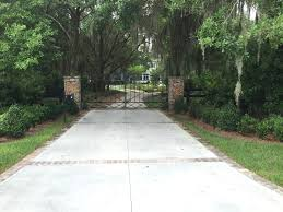 custom ornamental driveway gate and opener in lithia gate tech