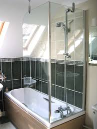 over bath shower light wall tiles make this small bathroom with