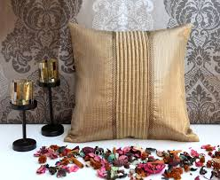 ans gold panneled cushion with pintucks and stitch lines at centre