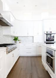 stained kitchen cabinets with hardwood floors white kitchen with caramel stained wood floors