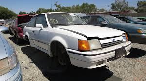 junkyard find 1988 ford escort gt