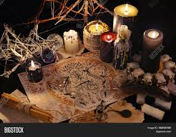halloween text symbols still life with demon drawing magic objects and black candles