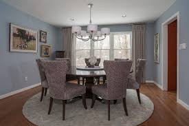 wingback dining chair dining room transitional with wood flooring