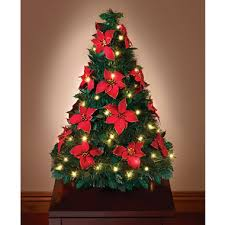 the pop up poinsettia tabletop tree hammacher schlemmer