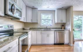 how to stain a kitchen cabinet question is it better to stain or paint cabinets kitchen