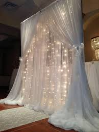 wedding arches decorated with tulle draped wedding arch with lights wedding ideas arch