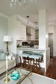 best ideas about small condo kitchen pinterest love the idea putting mirror under bar peninsula really makes tiny