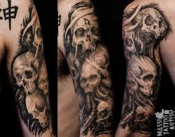 skulls with american flag tattoo on sleeve