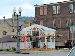 gazebo goes up in martins ferry news sports jobs the times t l photo shelley hanson jeremy yoder left and melvin miller work on building
