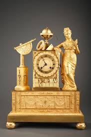 an interesting gilt bronze mantel clock with a complex iconography
