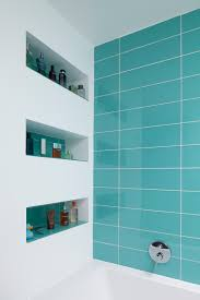 feature bold colour to bathroom tiles built in wall niche