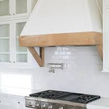 Rustic Kitchen Hoods - white french hood with rustic wood trim design ideas