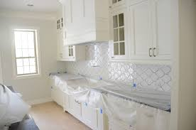 Flooring Chic Wooden Kitchen Cabinet In White With Quatrefoil - Walker zanger backsplash
