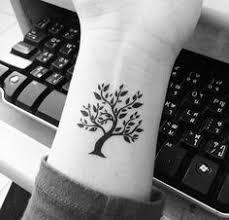 the 25 best small tree tattoos ideas on tiny tree
