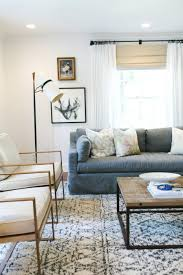 gorgeous brass chairs and gray sofa studio mcgee living dining
