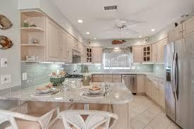Gray Backsplash Kitchen Beach House Kitchen With Crema Astoria Granite Countertops And A