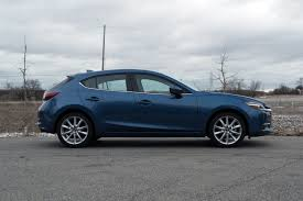 mazda 3 review 2017 mazda3 vs honda civic hatchback autoguide com news