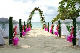 wedding arches supplies charming bamboo wedding arch in a with pink ribbons and sand