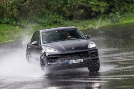 porsche suv blacked out we ride shotgun in the all new 2018 porsche cayenne on and off road