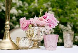 wedding centerpiece with pink ranunculus and peonies in mercury