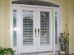 Exterior Door With Window Plantation Shutters On A Front Door Exterior View