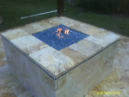 gas pit glass custom gas pit with blue glass and marble pavers
