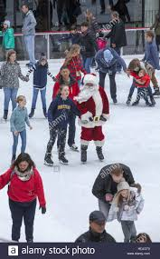 santa claus joins other skaters at rockefeller center the