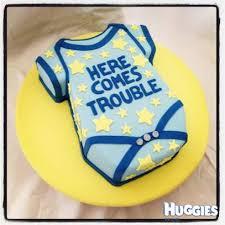 baby boy onesie here comes trouble baby shower cake huggies