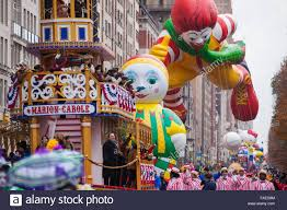 ronald mcdonald character balloon floats past crowds