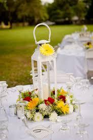 White Lantern Centerpieces by White Lantern Centerpiece With Yellow Daisy Rehearsal Ideas
