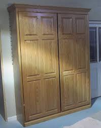 varnished oak wood queen murphy bed frame which adorned with hand