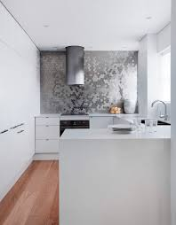 backsplash for black and white kitchen modern kitchen with white cabinets black appliances and gray counter