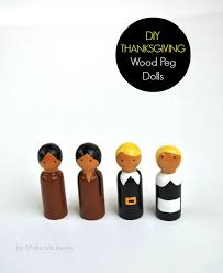diy thanksgiving pilgrim and indian wood peg dolls make lovely