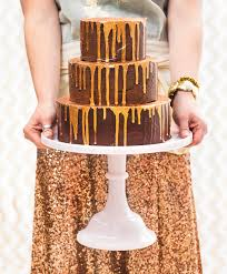 chocolate ganache wedding cake with golden drips nevie pie cakes