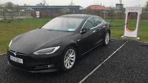 tesla outside tesla on a charge as it opens new base in ireland