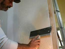 paul neumann knockdown drywall texture on wall with plastic bag