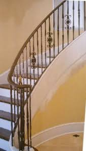 metal landing banister and railing wrought iron railing on a curved staircase and landing