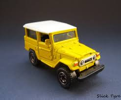 yellow toyota slick tyre diecast car collection matchbox toyota land cruiser