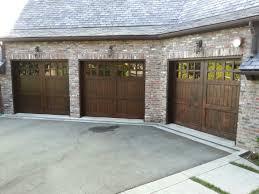 wooden up and over garage doors examples ideas pictures 878 746748 custom stain grade garage modern wood garage doors 1170x878 jpg pic wooden
